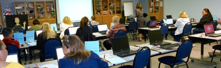 Teachers working in a computer lab