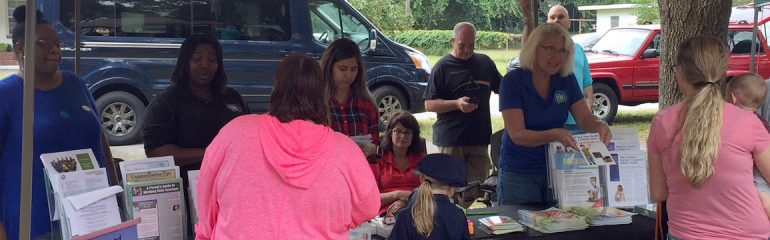 FDLRS Sunrise team talking to families at the Mulberry Harvest Festival.